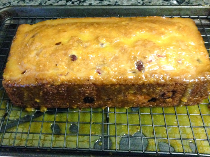 Glazed cake on wire rack with pan under to catch the drippings