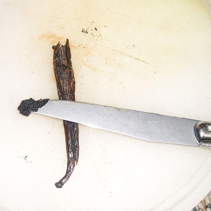 Scraping vanilla out of a vanilla bean pod